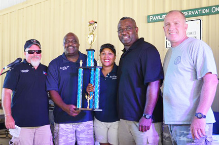 COMMUNITY OUTREACH. CLEAT President Todd Harrison(left) and CLEAT Regional Director Greg Shipley (right) pictured with Joseph Clarence and his BBQ Cook Off team from Mama and Papa Joe's BBQ in Converse, Texas. The team was the grand champion winner at the Peace Officers Memorial Foundation's BBQ Cook Off in San Antonio.